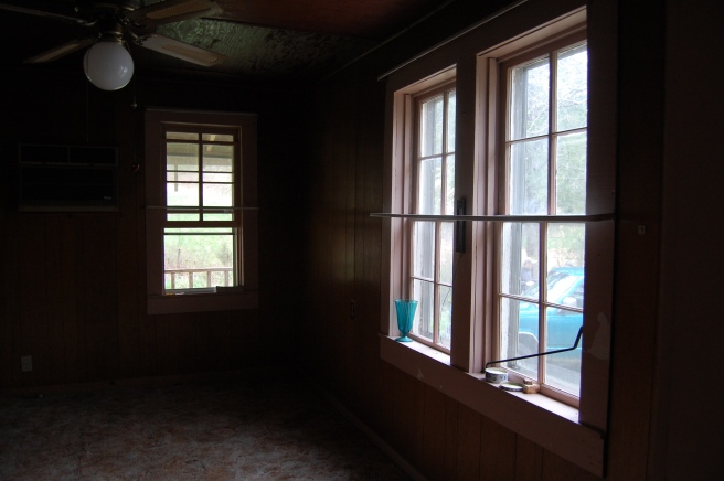 Living room, windows facing street